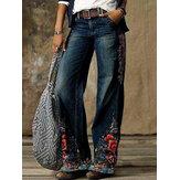 女性のカジュアルな花はポケット付きのカジュアルなスタイリッシュなジーンズをプリント