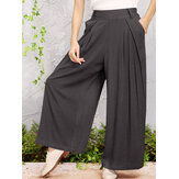 Wide-legged Elastic Waist Solid Color Pants With Side Pockets