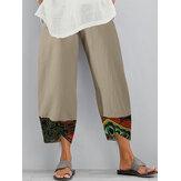 Impressão étnica patchwork cintura elástica bolso lateral bainha irregular Calças para mulheres