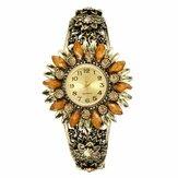 Deffrunレトロスタイルの女性のブレスレットの時計花の形の完全な鋼鉄バンドクォーツ時計