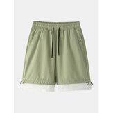 Pantaloncini casual larghi con coulisse in cotone tinta unita da uomo