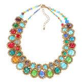 Collana con pettorina esagerata in oro con charm in cristallo multicolor