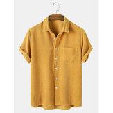 Conjunto fino de pana mostaza Cuello vuelto Bolsillo en el pecho Camisas de manga corta