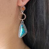 Boucles d'oreilles asymétriques émeraudes rétro