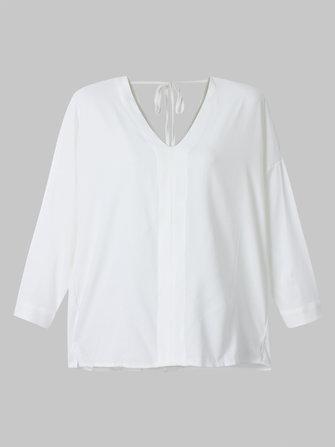 Seksowna, luźna koszulka z dekoltem w kolorze białym, bez rękawów